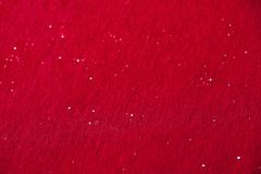 Dark red background with glitter dot. Dark red background with tiny glitter dot. Red paper with glitter dot. Abstract red background sprinkled with small Stock Photos