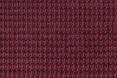 Dark red background from soft fleecy fabric close up. Texture of textiles macro.  Stock Images