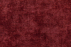 Dark red background from soft textile material. Fabric with natural texture. Stock Image