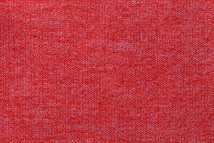 Dark red background from a textile material. Fabric with natural texture. Backdrop. Dark red background from a textile material. Fabric with natural texture Royalty Free Stock Photos