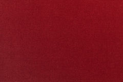 Dark red background from a textile material. Fabric with natural texture. Backdrop. Dark red background from a textile material. Fabric with natural texture Royalty Free Stock Photography