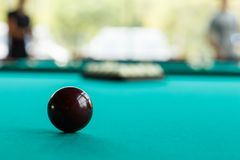 A dark red ball on the table cloth against the background of a blurry pyramid Royalty Free Stock Images
