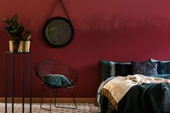 Dark red bedroom interior stock photos