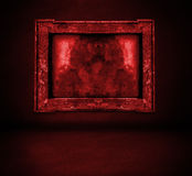 Dark red bloody wall with frame and floor interior Stock Photos