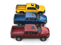 Dark red, blue and yellow modern pick-up trucks - top down side view Stock Image