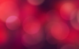 Dark red blurred holiday background. Red holiday blurred lights background.Christmas xmas dark wallpaper.Love concept backdrop Stock Image