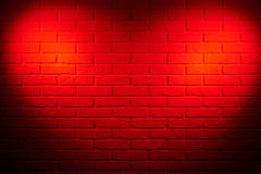Dark red brick wall with heart shape light effect and shadow, ab Royalty Free Stock Images