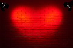 Dark red brick wall with heart shape light effect and shadow, abstract background photo, lighting equipment Stock Photo