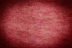 Dark red or brown knitted fabric texture Royalty Free Stock Images