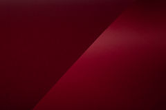 Dark red cardboard. Bent cardboard dark-red color Stock Images