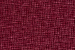 Dark red checked paper texture background. Stock Image