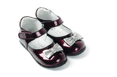 Dark red child shoes. With silver knots Stock Photo