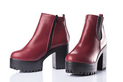 Dark red chunky heel boots Stock Image