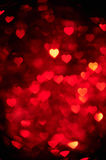Dark red color heart bokeh background photo. Abstract holiday, celebration backdrop. Royalty Free Stock Photography