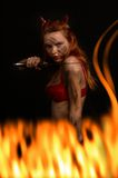 Dark red devil girl with a knife in fire Stock Images