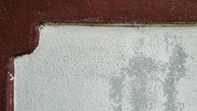 Dark red edge cement wall texture background Royalty Free Stock Photos