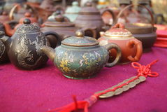 Dark-red enameled pottery teapot Royalty Free Stock Photos