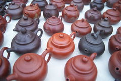 Dark-red enameled pottery teapot Stock Photos