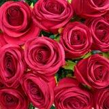 Dark red fake roses closeup Royalty Free Stock Photo