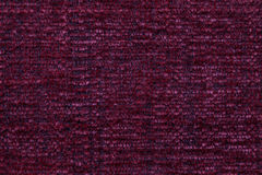 Dark red fluffy background of soft, fleecy cloth. Texture of textile closeup Stock Image