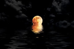 Dark red full moon in cloud with water reflection closeup showin Stock Photos