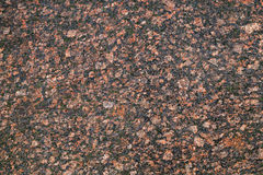 Dark red granite stone, background texture Stock Images