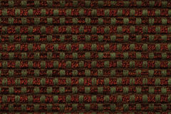 Dark red and green background from checkered pattern textile, closeup. Structure of the wicker fabric macro. Stock Photography