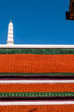 Dark red and green roof and white spire against a dark blue sky at Grand Palace, Thailand Royalty Free Stock Photos