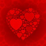 Dark red heart shape on maroon background Stock Photos