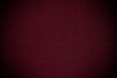 Dark red leather background. Texture, fabric pattern Royalty Free Stock Photos