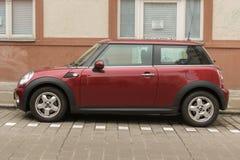 Dark red or maroon Mini Cooper car. HALLE (SAALE), GERMANY - CIRCA MARCH 2016: dark red or maroon Mini Cooper car Stock Images