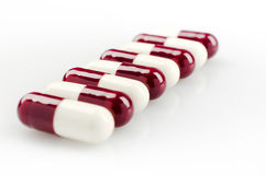 Dark Red Medical Capsules Stock Image