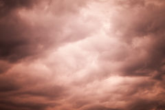 Dark red moody stormy clouds, natural sky background Stock Images