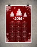 Dark red 2016 New Year calendar with white paper. Christmas trees and snowflakes, vector poster template at concrete wall background Stock Photos