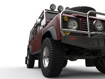 Dark red off road 4WD car - extreme closeup shot. Isolated on white background Royalty Free Stock Images