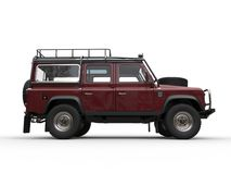 Dark red off road 4WD car - side view. Isolated on white background Stock Photography