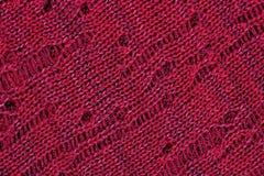 Dark red openwork melange stockinet as background Stock Photos