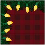 Retro Christmas Lights Frame with RedPlaid Background. Dark red plaid background with Christmas tree branches and yellow retro lights frame copy space Stock Photography