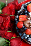 Dark Red Roses and Chocolate Cake with Berries Stock Images