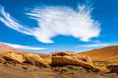 Sandy and gravel desert road through remote part of southern Altiplano, Bolivia royalty free stock images