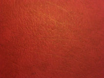 Dark red skin texture. With a golden pattern Royalty Free Stock Photo