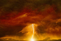 Dark red sky with lightning. Apocalyptic dramatic background - lightnings in dark red sky, judgment day, armageddon royalty free stock photography