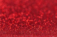 Dark red sparkling background from small sequins, closeup. Brilliant backdrop Royalty Free Stock Photo