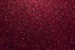 Dark red sparkling background from small sequins, closeup. Brilliant backdrop. Dark red sparkling background from small sequins, closeup. Brilliant shiny stock image