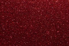 Dark red sparkling background from small sequins, closeup. Brilliant shiny backdrop from textile. Shimmer wine paper.  royalty free stock photos