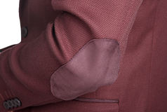 Dark red suit jacket for men, a patch on the elbow. Menswear, Close-up fragment of the male crimson jacket suit, a patch on the elbow stock photo