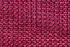 Dark red textile background with checkered pattern, closeup. Structure of the fabric macro. Royalty Free Stock Images