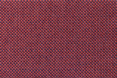 Dark red textile background with checkered pattern, closeup. Structure of the fabric macro. Stock Image