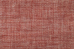 Dark red textile background with checkered pattern, closeup. Structure of the fabric macro. Royalty Free Stock Image