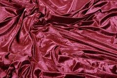 Dark red velvet background. Folded dark red velvet background stock image